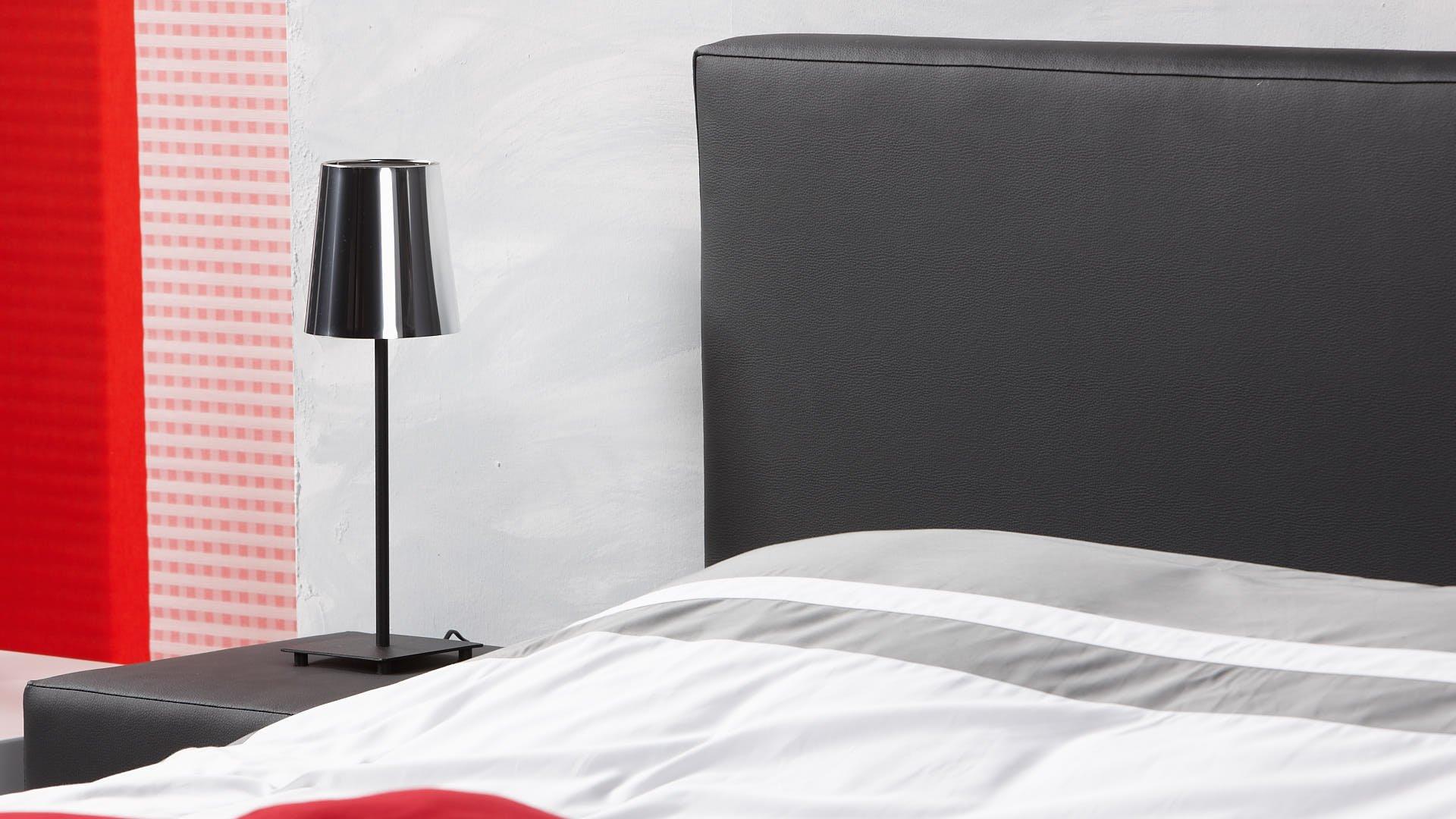 Wasserbett-Kopfteil genauso breit wie das Bett